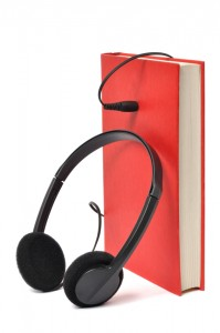 headphone plugged into a book